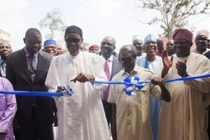 Acting Vice Chancellor, Edo University, Prof. Emmanuel Aluyor; President Muhammadu Buhari; Edo State Governor, Comrade Adams Oshiomhole and Lagos State Governor, Mr. Akinwunmi Ambode during the unveiling of the plaque to commission the Muhammadu Buhari Administrative Complex at the Edo University, Iyamho, Edo State, on Tuesday, November 8, 2016.