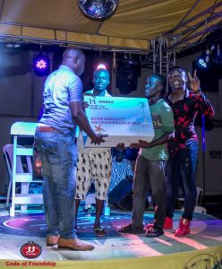 5. Comedian Bash celebrates with a winner and his friend in Lagos