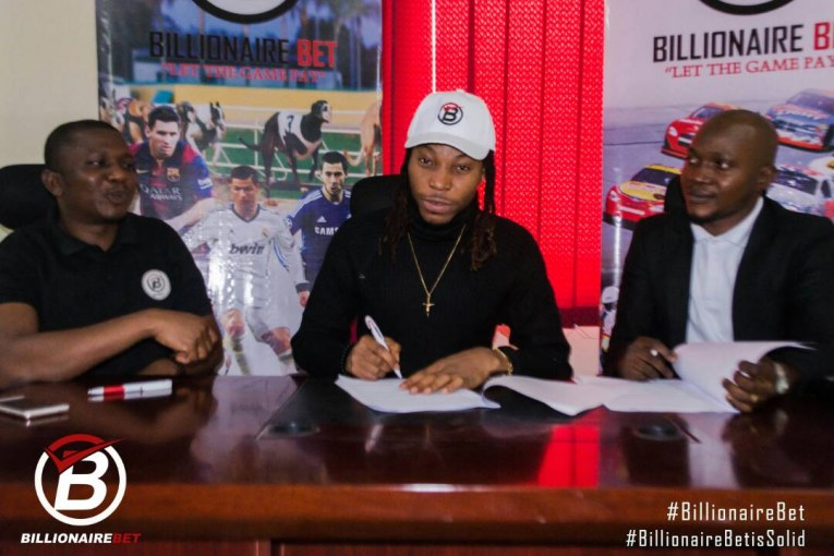 From L-R, Adole Kenneth, National Sales Manager, Billionaire Bet, Music Star Solidstar and Olayemi Oyewole, Marketing Director Billionaire Bet