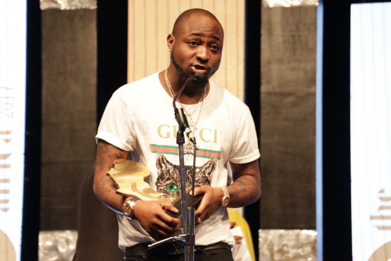 Davido picking up the award for The Future Awards Africa 2017 prize for Music