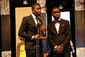 Oluyemi Oluwaseun Imole and Akanji Abayomi Gideon picking up The Future Awards Africa prize 2017 for Education endowed by the University of Sussex
