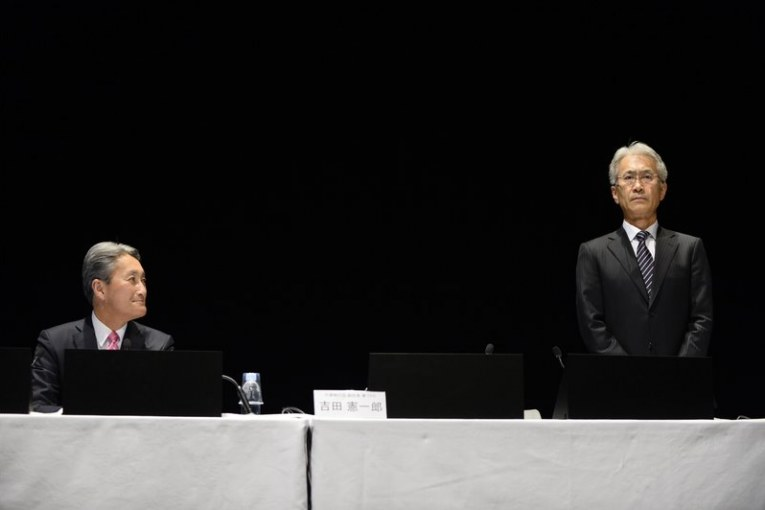 Kenichiro Yoshida, incoming chief executive officer of Sony Corp., right, stands as Kazuo Hirai, incoming chairman, looks on during a news conference in Tokyo, Japan, on Friday, Feb. 2, 2018. Sony will promote Yoshida to chief executive officer, replacing Hirai, rewarding its finance head for helping to restore earnings and the balance sheet of the Japanese electronics icon. Photographer: Akio Kon/Bloomberg via Getty Images