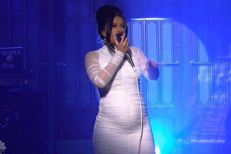 pregnant Cardi B performing on stage