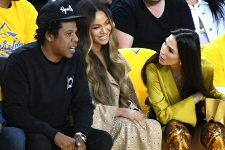Jay-Z and Beyoncé talk with Nicole Curran during the Golden State Warriors NBA Finals game against the Toronto Raptors at Oracle Arena in Oakland, Calif., on Wednesday, June 5, 2019. (Doug Duran/Bay Area News Group)