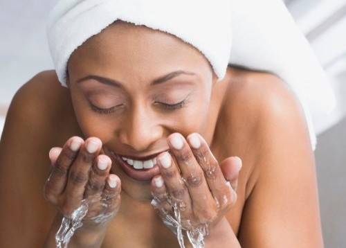 black model washing face