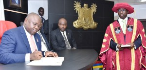 Lagos State Governor, Mr. Akinwunmi Ambode (left), signing the Oath of Office of the newly appointed Vice-Chancellor of Lagos State University, LASU, Prof. Olarenwaju Fagbohun (right), during the swearing in ceremony, at the Conference room, Lagos House, Ikeja, on Monday, January 11, 2016. With them are Chancellor, Lagos State University, LASU, Justice Adesola Oguntade, rtd., (2nd left) and the Special Adviser on Education, Mr. Fela Bank-Olemoh (2nd right).