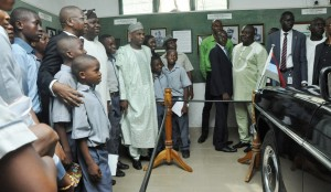 Minister of Information, Culture & Tourism, Alhaji Lai Mohammed; Lagos State Governor, Mr. Akinwunmi Ambode and Director General, National Commission for Museums & Monuments, Mallam Abdallah Yusuf with students of Paragon of Virtue Comprehensive College, Okota on excursion, viewing the car in which the former Head of State, General Muritala Muhammed was assassinated during a joint inspection visit to the National Museum, Onikan, Lagos, on Monday, March 07, 2016.