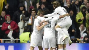 Real Madrid players celebrate after scoring a goal during the Champions League quarter-final second leg football match Real Madrid vs Wolfsburg at the Santiago Bernabeu stadium in Madrid on April 12, 2016. / AFP / JAVIER SORIANO        (Photo credit should read JAVIER SORIANO/AFP/Getty Images)
