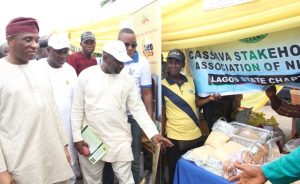 L-R: Representative of the Lagos State Governor and Secretary to the State Government (SSG), Mr. Tunji Bello; Commissioner for Agriculture, Hon. Toyin Suarau; Permanent Secretary, Ministry of Agriculture, Dr. Olayiwole Onsanya and Special Adviser on Food Security, Mr. Ganiu Okanlawon Sanni, admiring some farm produce made from cassava at the 2016 World Food Day grand finale held at the Johnson Agiri Agricultural Complex, Agege, on Sunday, October 16, 2016.