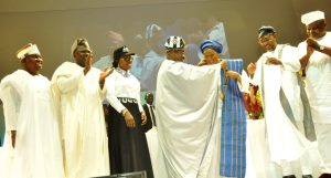 Lagos State Governor, Mr. Akinwunmi Ambode (2nd left), Senator Olamilekan Adeola Solomon; Wife of Lagos State Governor & Chairman, Committee of Wives of Lagos State Officials (COWLSO), Mrs. Bolanle Ambode; Oyo State Governor, Senator Abiola Ajimobi; Senator Oluremi Tinubu being decorated as Grand Matron of COWLSO, Osun State Governor, Ogbeni Rauf Aregbesola  and Speaker, Lagos State House of Assembly, Rt. Hon. Mudashiru Obasa during the opening ceremony of the 16th National Women Conference with the theme 'Strong Family, Strong Nation' organized by COWLSO, at the Convention Centre, Eko Hotel & Suites on Monday, October 24, 2016.