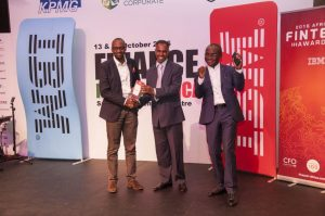 """Mr. Ken Njoroge and Mr Bolaji Akinboro being presented the  """"BEST PAYMENT AND TRANSFER COMPANY"""" award. (Left to Right.)"""