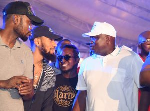 R-L: Lagos State Governor, Mr. Akinwunmi Ambode, with Hip-Hop/Rap Artists, Jude M.I Abaga; Phyno and Comedian, Omobaba during the Opening of the One Lagos Fiesta at the Agege Stadium, on Saturday, December 24, 2016.