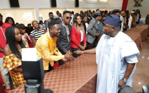 Lagos State Governor, Mr. Akinwunmi Ambode (right), with Hip-Pop musicians, Aramide (left); Adekunle Gold (2nd left); Patoranking (3rd left) and others during the Governor's meeting with Y2016 One Lagos Fiesta Artistes at the Banquet Hall, Lagos House, Ikeja, on Tuesday, January 17, 2017.