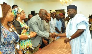Lagos State Governor, Mr. Akinwunmi Ambode (right), with musicians, Adewale Ayuba  (3rd left); Salawa Abeni (2nd left); Kenny St. Best (left) and others during the Governor's meeting with Y2016 One Lagos Fiesta Artistes at the Banquet Hall, Lagos House, Ikeja, on Tuesday, January 17, 2017.