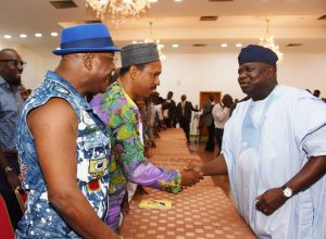 Lagos State Governor, Mr. Akinwunmi Ambode (right), with musicians, Alariwo of Africa (2nd left) and Sir Shina Peters (right) during the Governor's meeting with Y2016 One Lagos Fiesta Artistes at the Banquet Hall, Lagos House, Ikeja, on Tuesday, January 17, 2017.