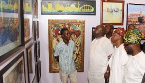 Lagos State Governor, Mr. Akinwunmi Ambode (2nd left); Minister of Information & Culture, Alhaji Lai Mohammed (2nd right); member,House of Representatives, Hon. Babajimi Benson (left) with Hebeeb Audu Artwoks (left) during the Opening of the Rasheed Gbadamosi Art Exhibition as part of activities to celebrate Lagos@50 at the Eko Hotel & Suites, Victoria Island, Lagos, on Friday, January 27, 2017.