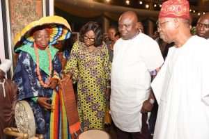 Lagos State Governor, Mr. Akinwunmi Ambode (2nd right); his wife, Bolanle (2nd left); Minister of Information & Culture, Alhaji Lai Mohammed (right), looking at the Nike Art Gallery, Chief (Mrs) Nike Okundaye (left) during the Opening of the Rasheed Gbadamosi Art Exhibition as part of activities to celebrate Lagos@50 at the Eko Hotel & Suites, Victoria Island, Lagos, on Friday, January 27, 2017