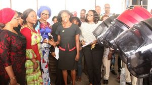 Wife of Lagos State Governor, Mrs. Bolanle Ambode (middle), presenting a hair making equipment to a beneficiary, Miss Taiwo Okunfeyiwa (2nd right) during the distribution ceremony of various empowerment material to graduates of the Lagos State Skill Acquisition Centres, Widows, Senior Citizens and others at the Blue Roof, LTV, Agidingbi, Lagos, on Monday, February 27, 2017. With them are Commissioner for Women Affairs & Poverty Alleviation, Mrs. Lola Akanda (2nd left), her counterpart for Youth & Social Development, Pharm. (Mrs) Uzamat Akinbile-Yusuf (left).