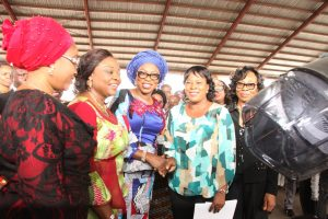 Wife of Lagos State Governor, Mrs. Bolanle Ambode (3rd left), presenting hair making equipments to a beneficiary, Mrs. Adenike Oyewola (2nd right) while the Commissioner for Women Affairs & Poverty Alleviation, Mrs. Lola Akanda (2nd left), her counterpart for Youth & Social Development, Pharm. (Mrs) Uzamat Akinbile-Yusuf (left) and Permanent Secretary, Ministry of Women Affairs & Poverty Alleviation, Mrs. Abiola Liadi (right) watch with admiration during the distribution ceremony of various empowerment material to graduates of the Lagos State Skill Acquisition Centres, Widows, Senior Citizens and others at the Blue Roof, LTV, Agidingbi, Lagos, on Monday, February 27, 2017.