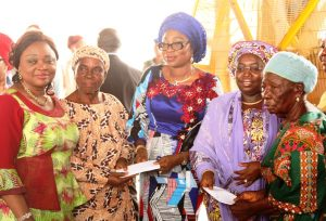 Lagos State Deputy Governor, Dr. (Mrs) Oluranti Adebule (2nd right); with wife of Lagos State Governor, Mrs. Bolanle Ambode (middle), jointly presenting gifts to widows – Mrs. Dorcas Feyisitan (right) and Mrs. Wuraola Adejare (2nd left) while the Commissioner for Women Affairs & Poverty Alleviation, Mrs. Lola Akanda (left) during the distribution ceremony of various empowerment material to graduates of the Lagos State Skill Acquisition Centres, Widows, Senior Citizens and others at the Blue Roof, LTV, Agidingbi, Lagos, on Monday, February 27, 2017.