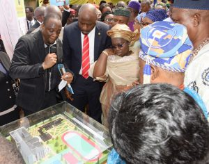 Representative of Lagos State Governor and Deputy Governor, Dr. (Mrs) Oluranti Adebule (3rd left); Special Adviser to the Governor on Education, Mr. Obafela bank-Olemoh and Project Director, Mr. Oluwole Sotire with the proposed Ultra Modern Building for the new Lagos State Model School during the Foundation Laying ceremony at Ojo, on Thursday, February 2, 2017.