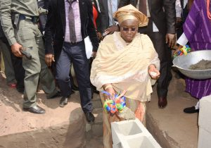 Representative of Lagos State Governor and Deputy Governor, Dr. (Mrs) Oluranti Adebule, performing the foundation laying for the proposed Ultra Modern School Building during the ceremony at Ojo, on Thursday, February 2, 2017.