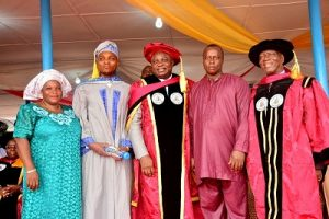 Lagos State Governor, Mr. Akinwunmi Ambode (middle), with the Best graduating Student,  Master Adedolapo Abdulazeez Ejire (2nd left); his mother, Mrs. Oluwakemi Ejire (left); his relative, Mr. Azeez Olawale (2nd right) and Chairman, Governing Council of Lagos State Polytechnic, Prof. Tajudeen Gbadamosi during the 25th Convocation ceremony of the Lagos State Polytechnic at the convocation ground, Ikorodu Campus, Ikorudu, Lagos, on Thursday, March 9, 2017.