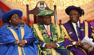 Lagos State Governor, Mr. Akinwunmi Ambode (middle), flanked by his Deputy, Dr. (Mrs) Aderanti Olubule (left) and Chancellor, Lagos State University, Justice George Oguntade (rtd) during the 21st Convocation ceremony of the Lagos State University at the University Auditorium Complex, Ojo, Lagos, on Thursday, March 23, 2017.