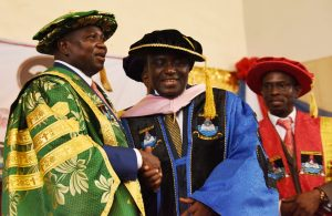 L-R: Lagos State Governor, Mr. Akinwunmi Ambode, congratulating Prof. Peter Okebukola with after being conferred as a Professor of Education & e-learning while the Vice Chancellor, Lagos State University, Prof. Olarenwaju Fagbohun, watches during the 21st Convocation ceremony of the Lagos State University at the University Auditorium Complex, Ojo, Lagos, on Thursday, March 23, 2017.
