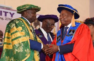 Lagos State Governor, Mr. Akinwunmi Ambode (left), congratulating Chief Adebutu Kessington (right) after being conferred with an honourary doctor of Science Communication during the 21st Convocation ceremony of the Lagos State University at the University Auditorium Complex, Ojo, Lagos, on Thursday, March 23, 2017. With them is the Chancellor, Lagos State University, Justice George Oguntade (rtd).