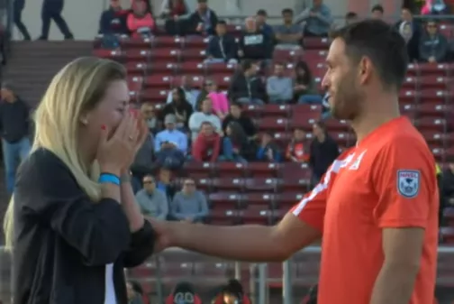 See photos of Footballer that got proposed on the field