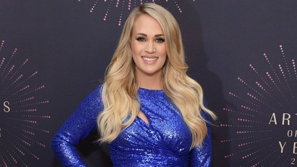 Carrie Underwood's Baby Bump Came to Party Last Night In Two Very Glittery Dresses